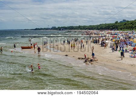 KOLOBRZEG, WEST POMERANIAN / POLAND - 2017: Sunny summer day on the sea beach