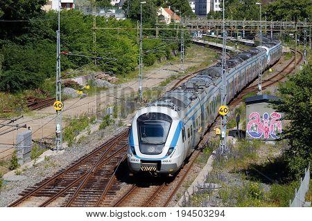 Sodertalje Sweden - June 28 2017: One commuter public transportation train class X60 in service for SL arrives the Sodertalje Centrum station.