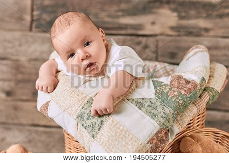 Small child with surprised face. Amazed caucasian infant. How to boost baby development.