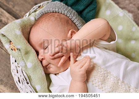 Sleepy caucasian child. Infant touching his face. Baby sleep schedule.