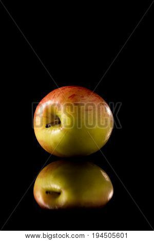 Red Apple On A Black Reflective Background