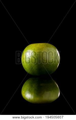 Tangerine Green Orange Fruit On A Black Reflective Background
