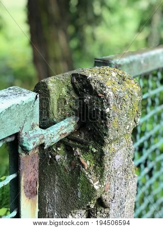 Dilapidated mental fence in the park