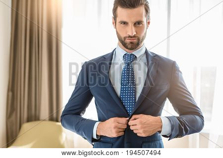 Young male business traveler hotel accomodation dress