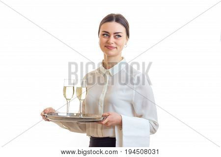pretty brunette waitress with silver trey in hands isolated on white background