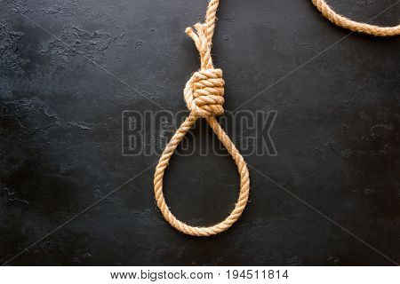 Running Knot Of Rope On A Black Background. Concept Stop Suicide