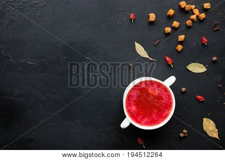Borscht In A White Plate With Herbs, Spices And Rusks On A Black Background With Space For Text