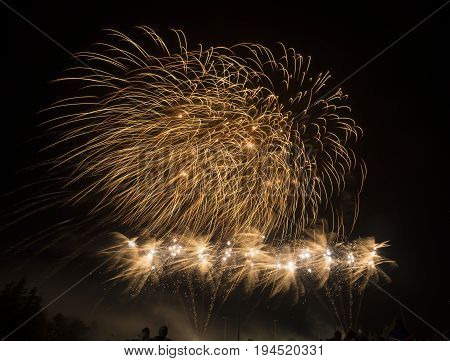 Beautiful Golden Firworks Display In The Night Sky During A Celebration