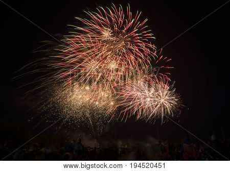 Gold And Red Sparkly Fireworks Bright In The Night Sky