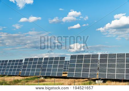 Solar power station with large panels under a cloudy sky