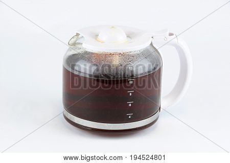 glass coffee pot with hot coffee isolated on white background