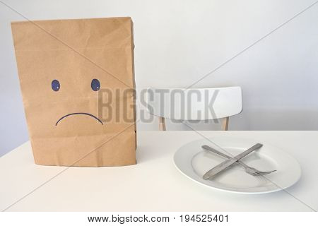 Eating disorder concept of unhappy person either hungry or not wanting to eat food. Copy space