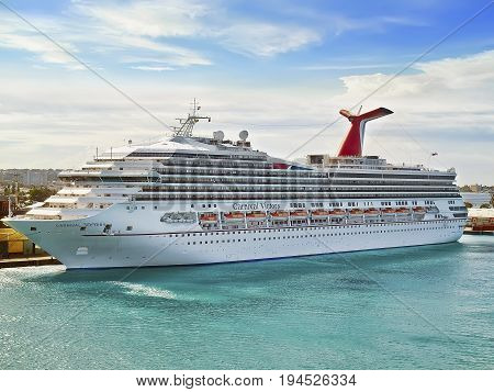 BRIDGETOWN, BARBADOS - APRIL 11,2012:  Cruise ship Carnival Victory, docked at Bridgetown on the Caribbean island  Barbados on a sunny day.