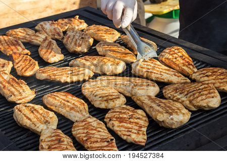 Photograph chicken fillets on the barbecue. grilled chicken fillets.