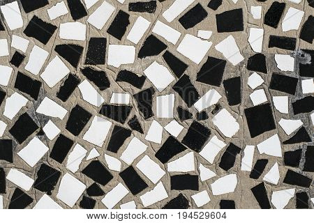 Texture Of The Old Wall Is Decorated With Mosaic Slices Of Ceram