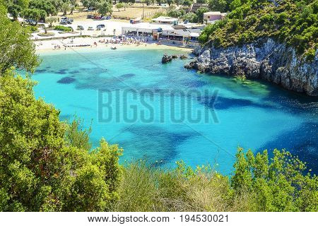 Aerial view on the bay and beach Paleokastritsa with crystal sea water on the Island Corfu Greece.