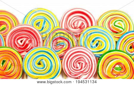 A lot of colorful lollipops for background