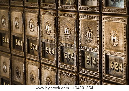 Rows of Old-Fashioned Post Office Boxes with Windows