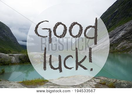 English Text Good Luck. Lake With Mountains In Norway. Cloudy Sky. Peaceful Scenery, Landscape With Rocks And Grass. Greeting Card