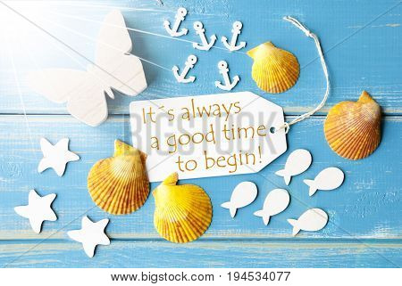 Flat Lay View Of Label With English Quote It Is Always A Good Time To Begin. Sunny Summer Greeting Card. Butterfly, Shells And Fishes On Blue Wooden Background