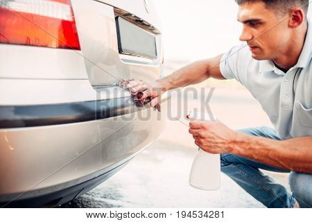 Automobile polishing on car wash station