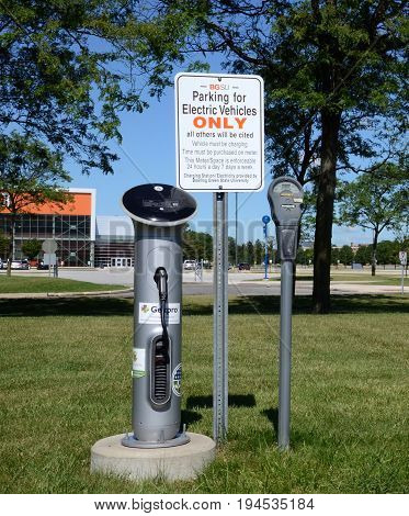 BOWLING GREEN OH - JUNE 25: An electric car charger at Bowling Green State University in Bowling Green Ohio is shown on June 25 2017.