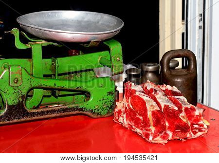Pieces of fresh raw meat on the counter for sale