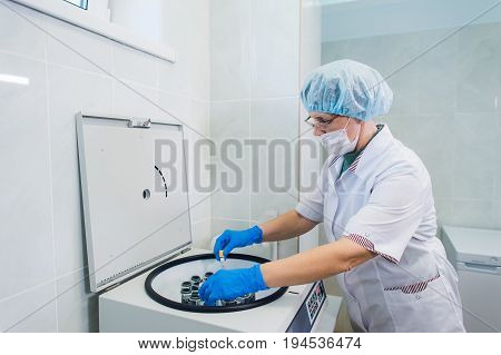 Platelet-Rich plasma preparation. Tube with blood in hands. Centrifuge.
