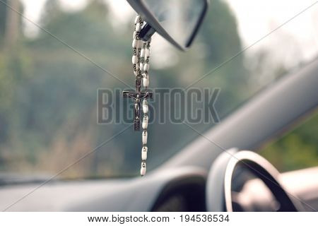 Rosary beads hanging in car