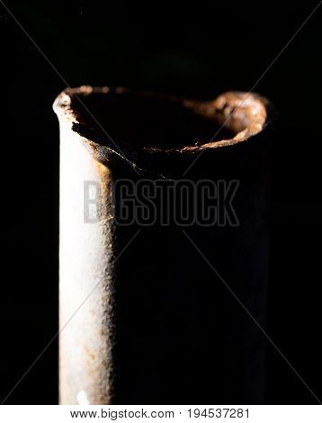 rusty pipe on black background . A photo