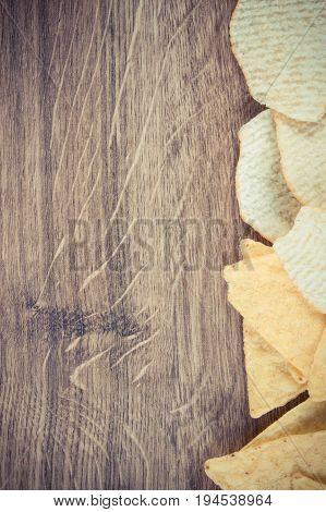 Vintage Photo, Crisps On Rustic Board, Concept Of Unhealthy Food
