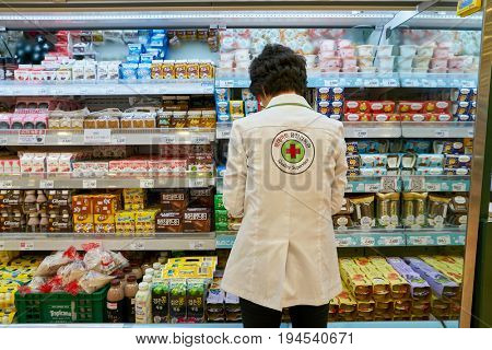 SEOUL, SOUTH KOREA - CIRCA MAY, 2017: quality supervisor at Lotte Mart in Seoul. Lotte Mart is an east Asian hypermarket that sells a variety of groceries, clothing, toys, electronics, and other goods
