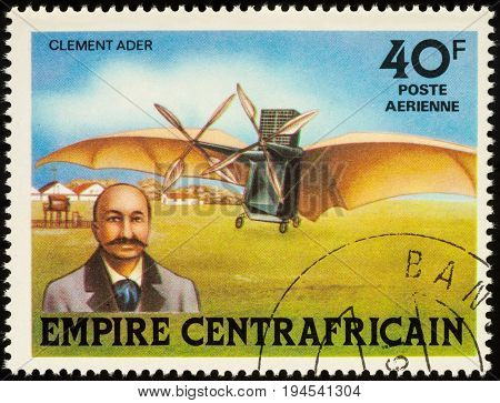 Moscow Russia - July 09 2017: A stamp printed in Central African Empire shows French aviation inventor Clement Ader and his airplane Avion III series