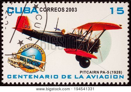 Moscow Russia - July 07 2017: A stamp printed in Cuba shows old American airplane Pitcairn PA-5 Mailwing (1928) series