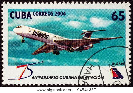 Moscow Russia - July 10 2017: A stamp printed in Cuba shows passenger aircraft IL 62M series