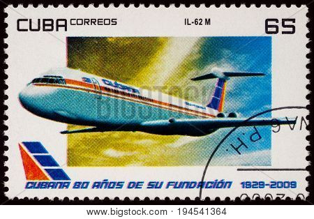Moscow Russia - January 18 2017: A stamp printed in Cuba shows passenger airliner Ilyushin IL-62M series