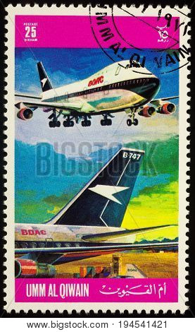 Moscow Russia - July 10 2017: A stamp printed in Umm al-Quwain shows passenger airliner Boeing 747 of BOAC (British Airways) series