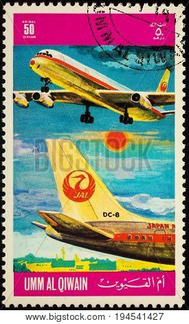 Moscow Russia - July 10 2017: A stamp printed in Umm al-Quwain shows passenger airliner Douglas DC-8 of JAL (Japan Airlines) series