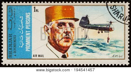 Moscow Russia - July 09 2017: A stamp printed in Sharjah shows President of France Charles de Gaulle and helicopter series