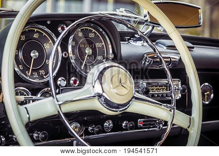 Novosibirsk Russia - June 16 2017: Mercedes-Benz 190 sl close-up of the steering wheel dashboard. Photography of a classic car on a street in Novosibirsk