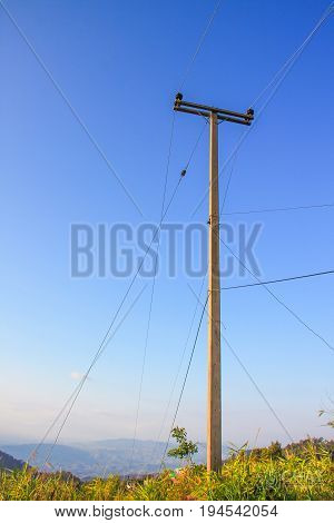wire pole on mountain of countryside withe blue sky in afternoon