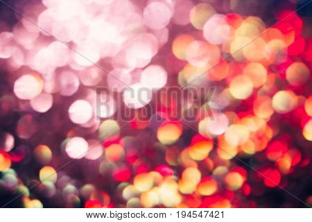 Abstract blurred light background, bright pink halo. Glitter in bokeh. Christmas wallpaper decorations concept. New year holiday festive backdrop. Sparkle circle celebrations display.