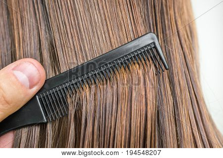 Close-up Of Dark Wet Hair With A Comb - Hair Care Concept