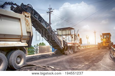 Large milling machine removing an old pavement layers at full depth