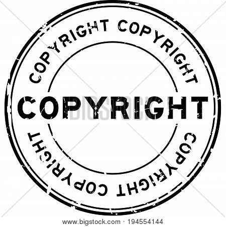 Grunge black copyright round rubber seal stamp on white background