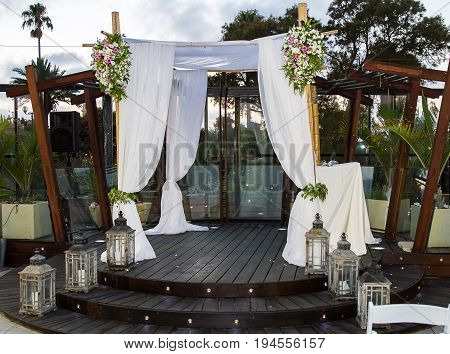 Beautiful photo of the Jewish Hupa wedding outdoor .