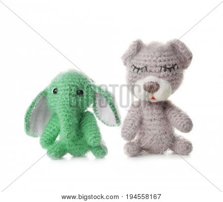Adorable crochet baby toys isolated on white