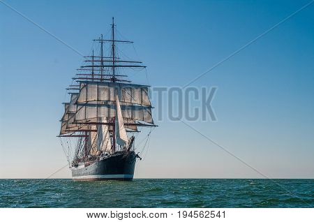 Clear sky, sunny afternoon , Four-masted barque front view
