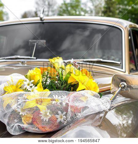 Multicolored flowers decoration on wedding car bonnet