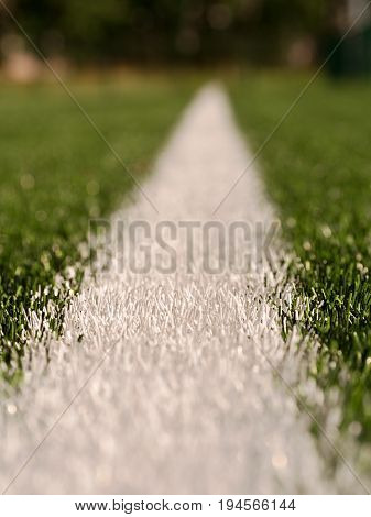 White Line Marks Painted On Artificial Green Turf Background. Winter Football Playground